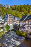 Monschau, view at the Rur with old ruin. Monschau, timbered houses at the Rur and the old castle ruin Haller at the mountain Stock Photography