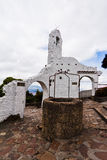 Monserrate Ruins and Well Bogota Colombia. The ruins of a house with white walls and a stone well in Monserrate Hill, Bogota, Colombia Stock Photos