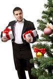 Monsieur avec des cadres de cadeau Image stock