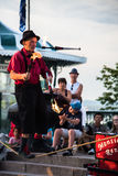 Monsieur Rene entertains tourists at Terrasse Dufferin. Royalty Free Stock Images