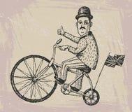 Monsieur sur une bicyclette Image libre de droits