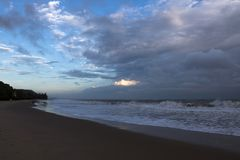 Monsoon Arriving. Dark clouds of monsoon arriving on the shore, on a bright sunny day. Start of the monsoon season in India Stock Photography