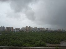 Dark Monsoon clouds over Indian city stock images