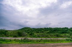 Monsoon clouds over lush green hills Stock Image