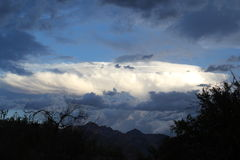 Monsoon clouds over the mountains in Tucson, Arizona. Desert mountain landscape with huge clouds Royalty Free Stock Photo