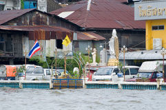 Monsoon flooding in Bangkok October 2011. BANGKOK, THAILAND - OCTOBER 17: Car parked at the flooding Chao Praya River during the worst flooding in decades in Royalty Free Stock Image