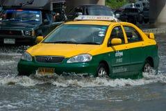 Monsoon rain in Bangkok, Thailand. Bangkok, 14 August 2009: Taxi navigating through the flood after the heaviest monsoon rain in the capital in Thailand in 20 Royalty Free Stock Photography