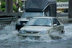 Monsoon rain in Bangkok, Thailand. Bangkok, 14 August 2009: Car and truck navigating through the flood after the heaviest monsoon rain in the capital in Thailand Royalty Free Stock Images