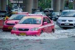Monsoon rain in Bangkok, Thailand. Bangkok, 14 August 2009: Cars and trucks navigating through the flood after the heaviest monsoon rain in the capital in Royalty Free Stock Images