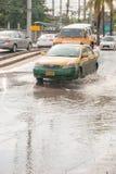 Monsoon rain in Nonthaburi, Thailand. Nonthaburi: Cars and trucks navigating through the flood after the heaviest monsoon rain in the capital in Thailand Royalty Free Stock Photos