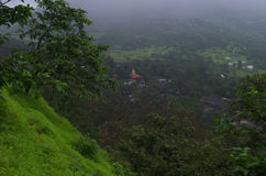 Monsoon scene of an Indian village. A beautiful landscape of an Indian village with a smog covered over a village Royalty Free Stock Images