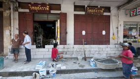 Monsoon season in Ayuttaya, Thailand 2011. AYUTTAYA, THAILAND - OCTOBER 5: Shop owners building a brick wall to protect their shops from flooding during the royalty free stock image