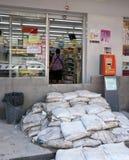 Monsoon season in Ayuttaya, Thailand 2011. AYUTTAYA, THAILAND - OCTOBER 5: Convenience store protected against flooding during the monsoon season in Ayuttaya royalty free stock photos