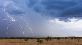 A Monsoon Storm Moves Across the Desert. A Monsoon Thunderstorm Moves Across a Desert Grassland Royalty Free Stock Images