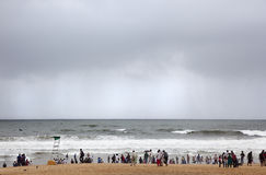 Monsoons on the horizon. Calangute, India-August 31, 2012.While Indian tourists enjoy the beach, on the horizon is the torrential rains of the monsoon will soon Royalty Free Stock Photography