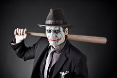 Monster. The person on similarity of the monster with a baseball bat in hands Stock Photo