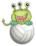 A monster above the ball Royalty Free Stock Image