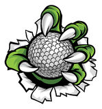 Monster or animal claw holding Golf Ball Stock Photo