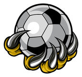 Monster animal claw holding Soccer Football Ball. A monster or animal claw or hand with talons holding a soccer football ball Royalty Free Stock Images