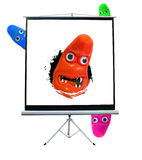 Monster break through movie screen. Photo of a bright multi-coloured blob monsters breaking through a movie projection screen...ideal for own text Royalty Free Stock Images