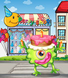 A monster with a cake above the head Royalty Free Stock Images