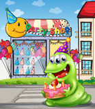 A monster with a cake standing at the pedestrian lane Stock Image