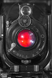 Monster Camera. An antique camera, scrubbed of all logos, trademarks or brand names, glows red from the lens as though it is haunted Royalty Free Stock Photography
