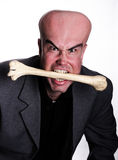 Monster. Cannibal man in suit eating bone Stock Photography
