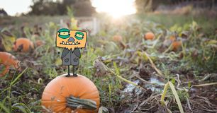 Monster cartoon standing on halloween pumpkin Royalty Free Stock Photography