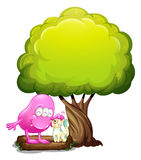 A monster and a cat under the tree Royalty Free Stock Images