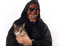 The monster and the cat. Woman wearing a monster costume with a cat Royalty Free Stock Image