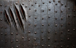 Monster claw scratches on metal wall or door. Background royalty free stock photography