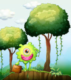 A monster at the cliff holding a bag. Illustration of a monster at the cliff holding a bag Royalty Free Stock Images