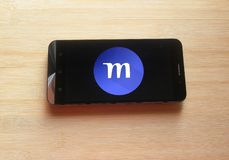 Monster.com app. On smartphone kept on wooden table royalty free stock images