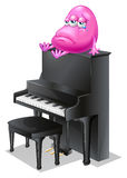 A monster crying above the piano Stock Photos
