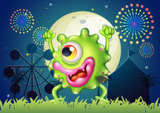 A monster dancing at the carnival in the middle of the night Royalty Free Stock Photography