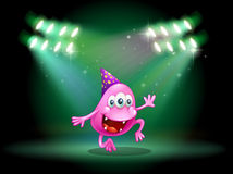 A monster dancing in the middle of the stage Royalty Free Stock Photos