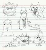 Monster doodles set 1. Monster doodles on a notebook paper. Set number 1 Royalty Free Stock Images