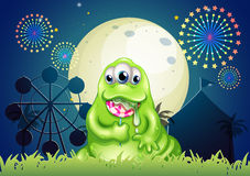 A monster eating a lollipop at the amusement park Royalty Free Stock Photo