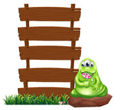 A monster beside the empty wooden boards Stock Photos