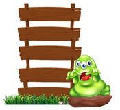 A monster beside empty wooden signboards Stock Photos