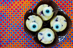 Monster eye cupcakes for Halloween party on colorful background Royalty Free Stock Photo