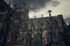 Monster eyes above old church. Is good unreal photo to have show on Halloween Stock Photo