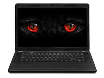 Monster eyes looking to the laptop screen Royalty Free Stock Images
