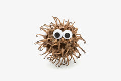 Monster face. Real lovely monster with googly eyes on white background Stock Image