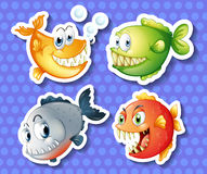 Monster fish. Four monster looking fish on blue screen Royalty Free Stock Images