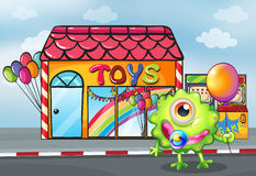 A monster in front of the toy shop Stock Image