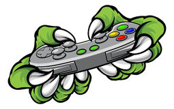 Monster Gamer Claws Holding Games Controller. Monster gamer player hands or claws holding a controller playing video games Stock Image