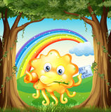 Monster with get-well-soon card and rainbow in sky Stock Images