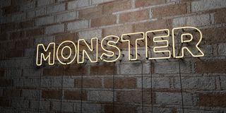 MONSTER - Glowing Neon Sign on stonework wall - 3D rendered royalty free stock illustration Royalty Free Stock Photography